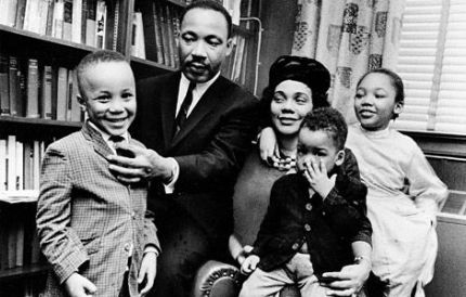 Dr. Martin Luther King, Jr. and his wife, Coretta Scott King, sit with three of their four children in their Atlanta, Georgia, home in 1963.  (Photograph courtesy Associated Press)